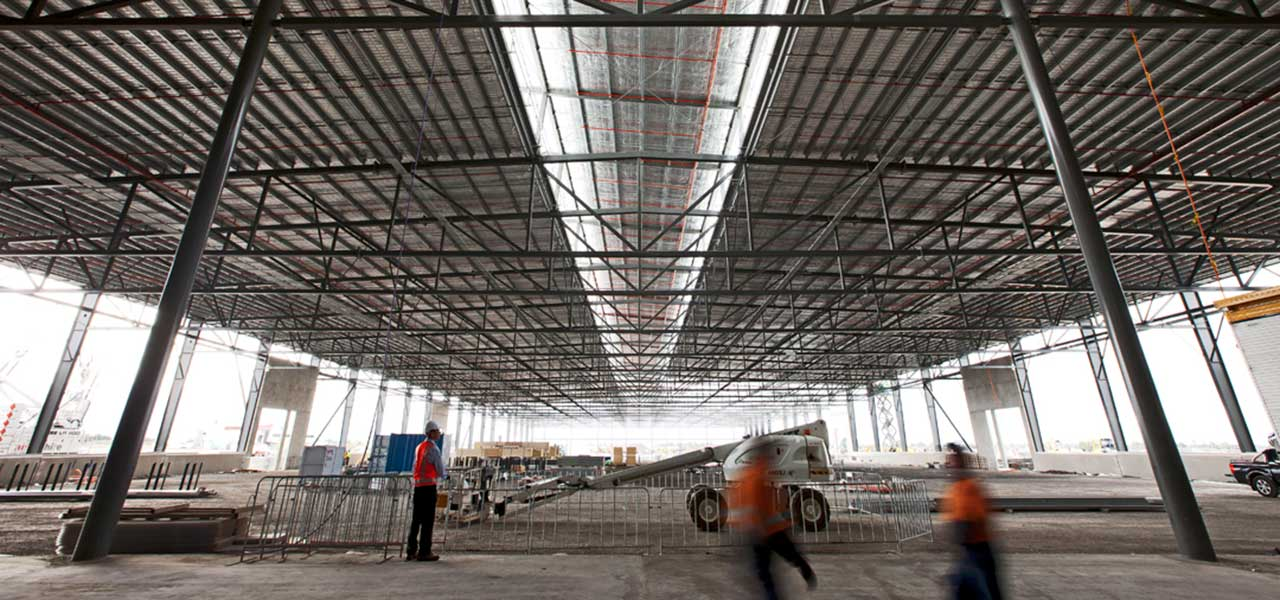 01-mechcon-case-study-balustrade-handrails-pressure-pipe-fabrication-steel-roof-plant-platforms-upgrade-melbourne-markets-1200x600px.JPG