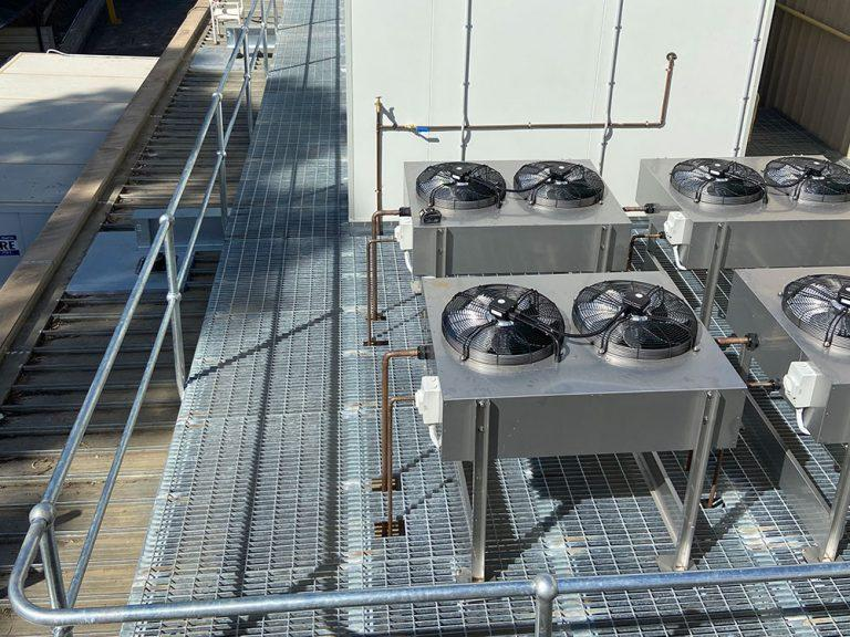A roof plant platform with industrial exhausts and aircon.